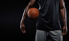 Afro american basketball player holding a ball Royalty Free Stock Images