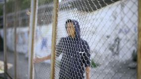 Free Afro-american Boy Behind Fence, Migrant Child Separated From Family, Detained Stock Image - 137530391