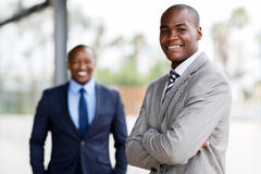 Afro american business man. Good looking afro american business men with colleague on background royalty free stock images