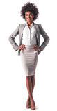Afro American business woman. Full length portrait of beautiful young Afro American business woman in formal wear smiling while standing akimbo, isolated on Stock Photo