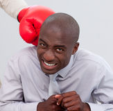 Afro-American businessman being boxed Stock Images