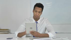Afro-American Businessman Browsing Internet on Tablet. 4k high quality, 4k high quality stock video footage