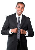 Afro-American businessman correcting a tie Stock Photography