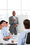 Afro-American businessman discussing with his team Royalty Free Stock Image