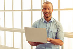 Afro American businessman with gadget Stock Photography