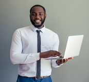 Afro American businessman with gadget Royalty Free Stock Photos