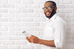 Afro American businessman with gadget Stock Image
