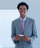 Afro-American businessman giving a presentation stock photos