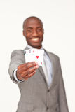 Afro-American businessman holding  aces Royalty Free Stock Photography
