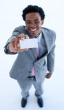 Afro-American businessman holding a card Royalty Free Stock Photos