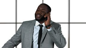 Afro-american businessman holding phone. stock video