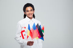 Afro american businessman holding world flags Royalty Free Stock Photos