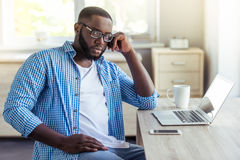 Afro American businessman at home Stock Photography