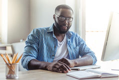Afro American businessman at home Stock Photo