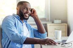 Afro American businessman at home Royalty Free Stock Photos