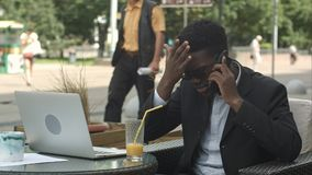 Afro-American businessman negotiating by phone, defending his interests and opinion. Professional shot in 4K resolution. 105. You can use it e.g. in your stock images
