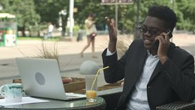 Afro-American businessman negotiating by phone, defending his interests and opinion. Professional shot in 4K resolution. 105. You can use it e.g. in your stock footage
