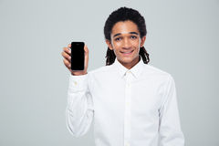 Afro american businessman showing blank smartphone screen Royalty Free Stock Photo