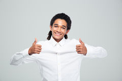 Afro american businessman showing thumbs up Royalty Free Stock Images