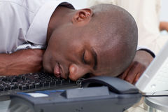 Afro-American businessman sleeping on the keyboard Royalty Free Stock Photography