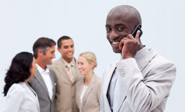 Afro-American businessman talking on mobile phon Royalty Free Stock Photo
