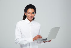 Afro american businessman using laptop Stock Photography