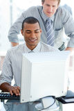 Afro-american businessman working at a computer Stock Image