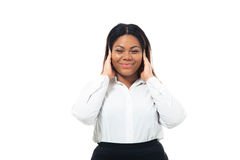 Afro american businesswoman covering her ears Stock Photography
