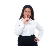Afro american businesswoman with finger over lips Stock Image