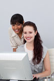 Afro-American businesswoman helping her colleague Stock Photos