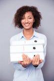 Afro american businesswoman holding folders Stock Image