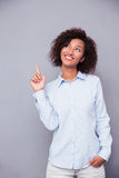 Afro american businesswoman pointing funger up Stock Image