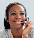 Afro-American businesswoman using headset Stock Image
