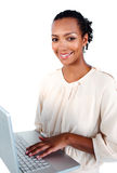 Afro-american businesswoman using a laptop Stock Photography