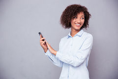 Afro american businesswoman using smartphone Stock Photography