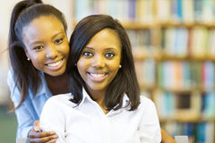 Afro american college students. Portrait of beautiful young afro american college students Royalty Free Stock Photography