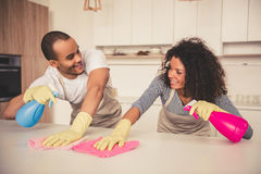 Afro American couple cleaning Royalty Free Stock Photo