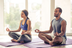 Afro American couple doing yoga Stock Photos