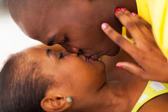 Afro american couple kissing Royalty Free Stock Photography
