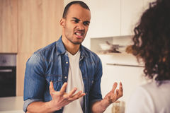Afro American couple in kitchen Royalty Free Stock Photos