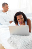 Afro-american couple relaxing on their bed Royalty Free Stock Image