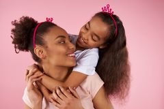 Afro American daughter and mother in sham crowns royalty free stock photography