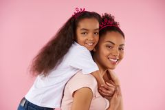 Afro American daughter on piggy back ride stock photos