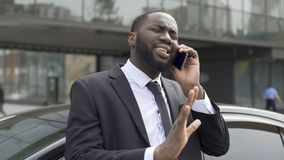 Afro-American diplomat negotiating by phone, defending his interests and opinion. Stock footage stock footage