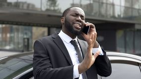 Afro-American diplomat negotiating by phone, defending his interests and opinion. Stock photo royalty free stock image