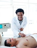 Afro-american doctor examining a patient Royalty Free Stock Images
