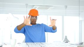 Afro-American Engineer Imagining New Ideas, Blueprint on Desk. 4k , high quality Royalty Free Stock Image