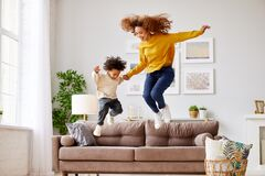 Free Afro American Family Mom And Son Having Fun In Living Room At Home Stock Photography - 216796602