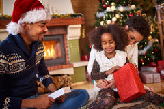 Afro American family opening Christmas present Royalty Free Stock Image