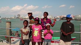 Afro-American family sings a song on the shore of the Gulf of Siam in Pattaya. Part 3